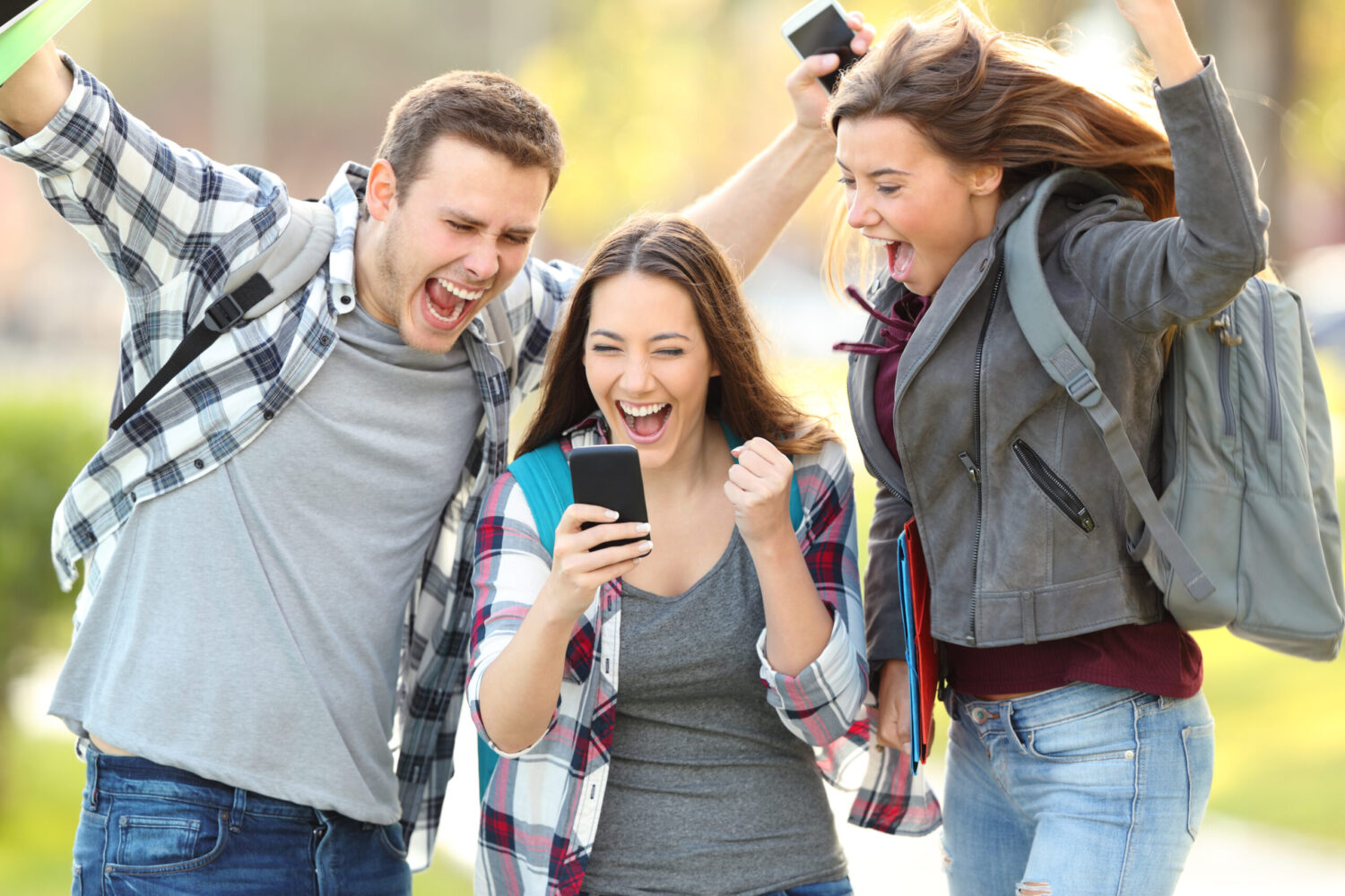 Three,Excited,Students,Checking,Exam,Grades,Online,In,A,Smart